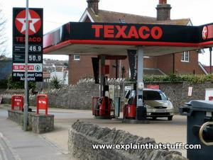 Cars waiting at a gas station in England.