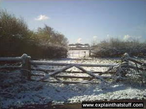 A wooden gate in winter snow