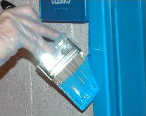Blue gloss paint being applied to a door