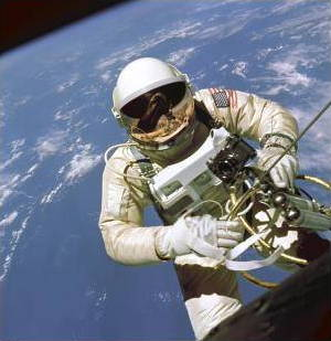 Gold: An astronaut supported by a gold tether with a gold visor on his helmet