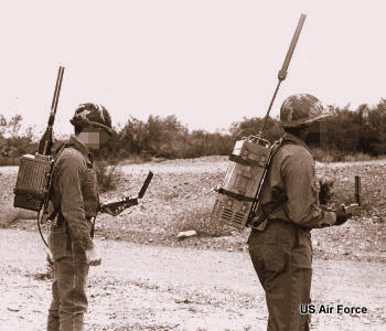 How GPS has improved: two soldiers navigating with large GPS rucksack equipment in 1978.