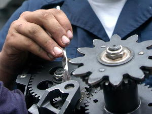 Greasing machine gears.