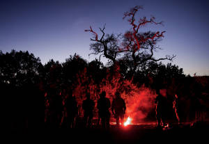 Aeromedical students set off rescue flares as night falls.