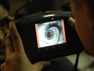 A handheld iris scanner in action