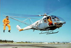 A helicopter with its center of gravity shifted to one side by a load.