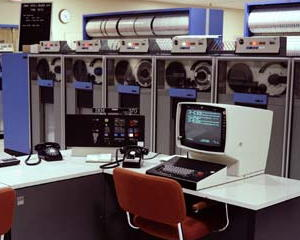 An IBM System/370 mainframe computer with tape drives in the background.