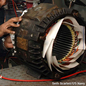 The inside of an AC induction motor being rewound.