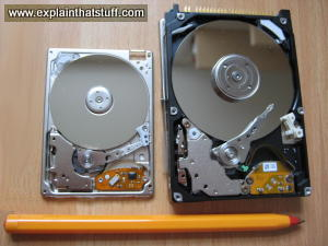 A 20GB iPod PCMCIA hard drive and a 30GB laptop hard drive (inside view), both made by Toshiba.