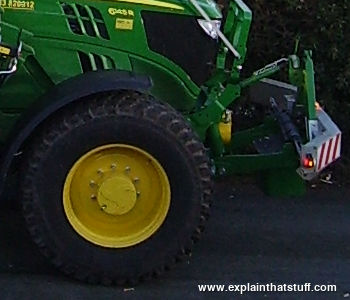 Closeup photo of the front hitch on a John Deere tractor seen from the side