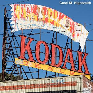 Old vandalized Kodak dealer sign.