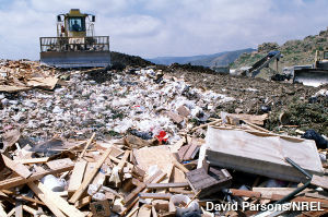 landfill site with garbage and a bulldozer