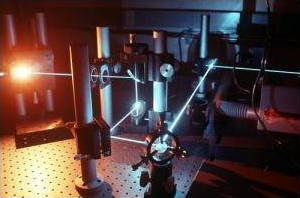 Laser beams follow precise paths between mirrors in a laboratory experiment.