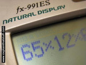LCD pocket calculator screen showing numbers made from pixels.
