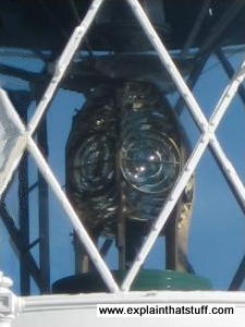 Closeup of a lighthouse lamp showing the Fresnel lens and prisms.