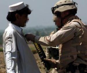 Soldiers using a Garrett metal detector