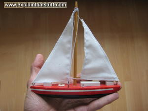 A wooden model of a yacht.