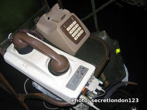 An old-style acoustic coupler modem with a telephone plugged in.