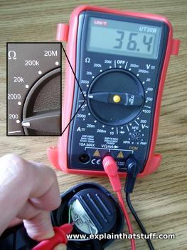 Measuring the resistance of an electronic component with a multimeter.