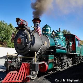 Narrow gauge, turquoise-colored steam engine with red cow catcher on the Tweetsie Railroad North Carolina by Carol M. Highsmith