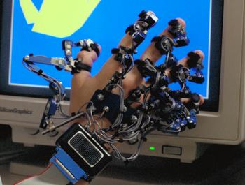 Closeup of a virtual reality dataglove showing how the individual knuckles and fingers are monitored.