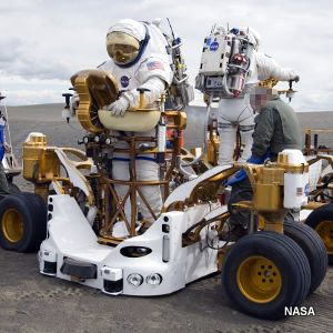 Astronauts test ground-penetrating rover and LIDAR units in twin K10 rovers at Moses Lake dunes.
