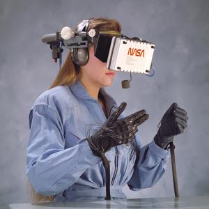 A NASA Ames scientist demonstrates virtual reality headset and data gloves