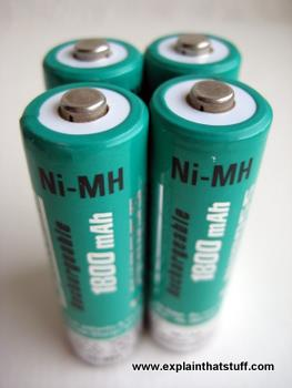 Four green and silver nickel metal hydride NiMH batteries