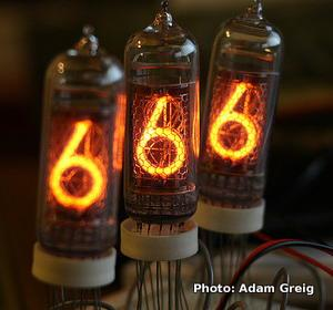 Three nixie tubes spell out the numbers 666.