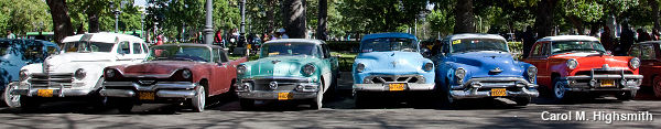 A row of classic American cars in Cuba, seen from the front, by Carol M. Highsmith.
