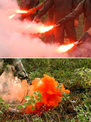 Top: A group of orange smoke flares being set off. Bottom: Closeup of an orange smoke flare.