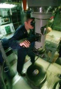 Sailor looking through a periscope