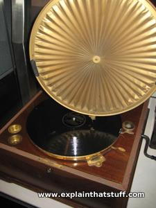 A windup phonograph with needle on a 78 record and Sterling Primax sound amplifying horn