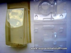 Two plastic containers, one that has photodegraded to a yellow color and one that is still transparent