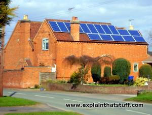 Photovoltaic solar panels covering the roof of a house in England.