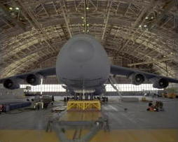 A giant C5 airplane having its center of gravity calculated.