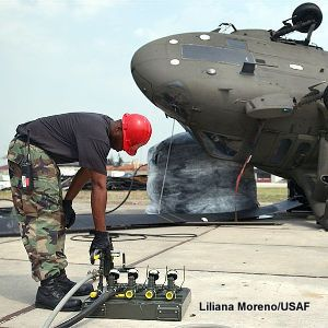Lifting an overturned helicopter with a pneumatic airbag.
