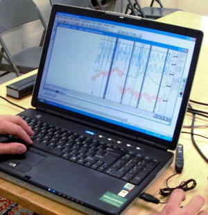 A modern polygraph trace on a laptop screen.