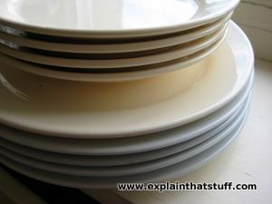 A stack of cream-colored porcelain dinner plates