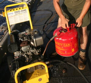 Filling up a gasoline-powered pressure washer