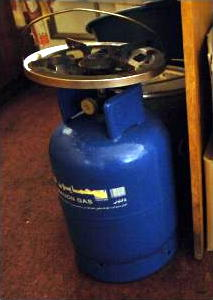 Blue propane cylinder with cooking ring on top
