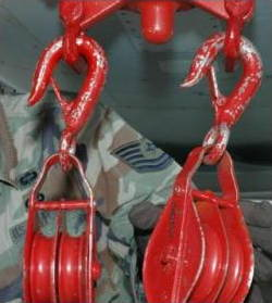 Red pulley wheels hanging by hooks