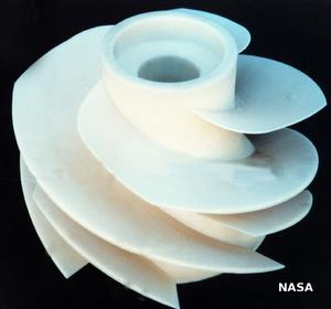 A typical white plastic impeller from inside a pump.