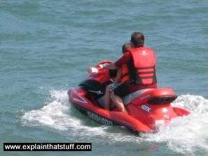 Photo of a Sea-Doo personal watercraft picking up speed