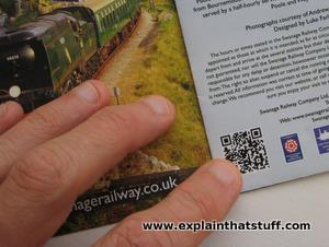 Example of a QR code being used to good effect on a promotional marketing leaflet.
