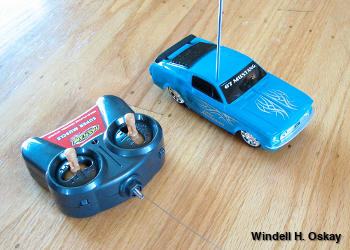 Blue radio controlled Ford Mustang car and Super Muscle RC unit with antenna extended.