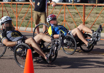 Two recumbent bicycles side by side in a race.