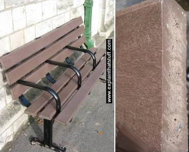 Public bench seat made of recycled plastic with closeup of plastic woodgrain effect.