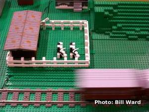 LEGO® cows on a model railroad operated by a reed switch