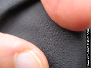 A closeup photo of ripstop nylon showing the rectangular grid of reinforcement that stops rips from spreading.