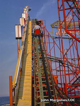 A rollercoaster car being winched back to the top of the ride. Photo shows Jet Star roller coaster, Seaside Heights, New Jersey, by John Margolies/LOC.